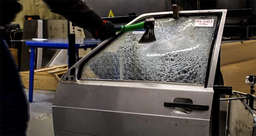 Test of vandal-proof glass by hand, axe